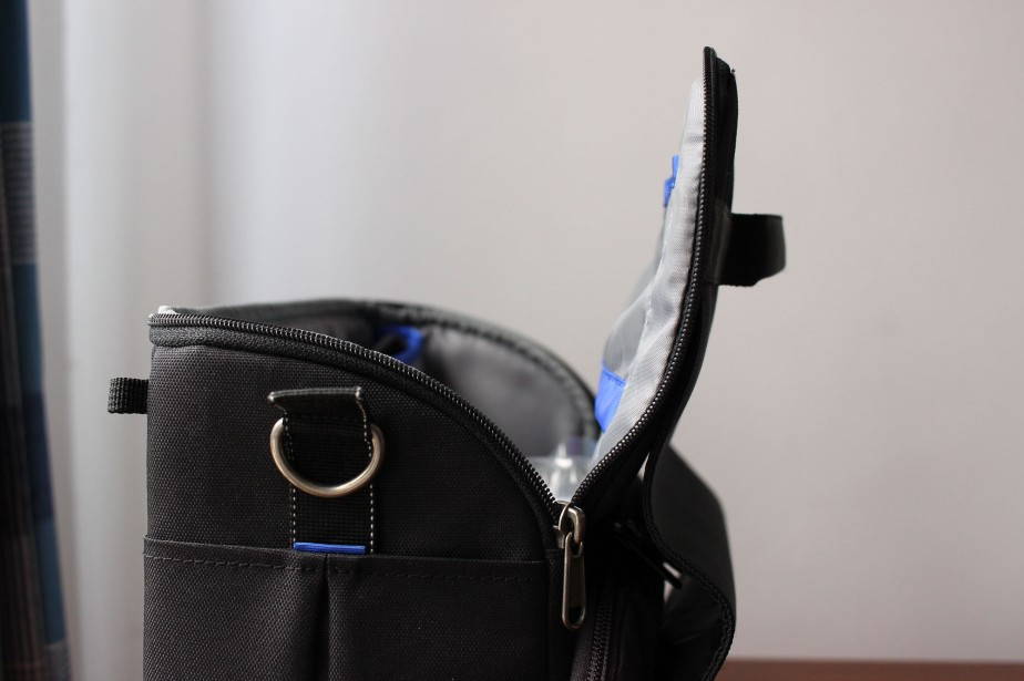 When unzipped, the flap tends to keep the position you give it: opened or closed. It's reliable.