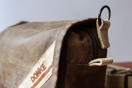 The sides of the bag have a pull-tab in addition to the loops.